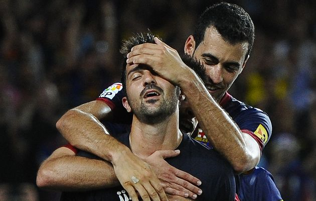 David Villa celebrates with team mates against Real Sociedad