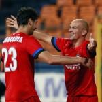 Esteban Cambiasso, right, celebrates scoring against FC Vaslui with Andrea Ranocchia