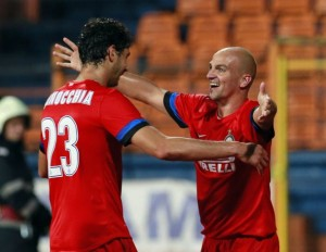Esteban Cambiasso, right, celebrates scoring against FC Vaslui with Andrea Ranocchia