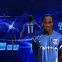 Drogba posing in his Shanghai jersey