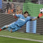 Real Madrid's Casillas fails to make a save as Barcelona's Messi scores his second goal during their Spanish first division soccer match at Nou Camp stadium in Barcelona