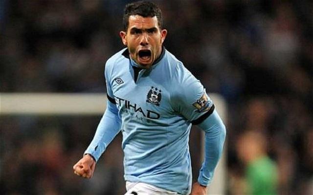 Manchester City 1 -0 Swansea City . Carlos Tevez celebrates his goal.