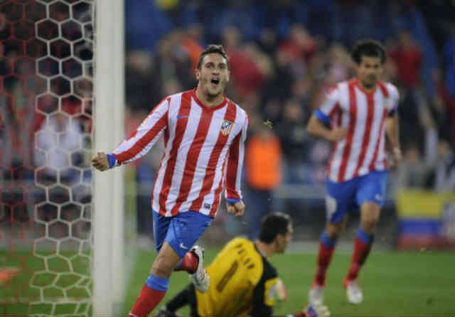 Atletico Madrid thrashed Sevilla 4-0 to draw level with Barcelona at the top of La Liga