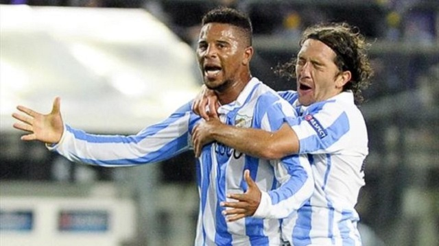 Malaga still finish top of Group C despite twice letting a goal lead slip against Anderlecht.