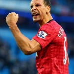 Rio Ferdinand celebrates despite getting hitting in the eye with a coin