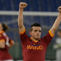 AS Roma's Alessandro Florenzi celebrates after scoring during the Italian cup first leg semifinal soccer match between AS Roma and Inter of Milan in Rome