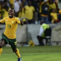 Hosts South Africa finished top of Group A after their dramatic 2-2 draw with Morocco in Durban knocked the North Africans out of the African Cup