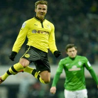 Mario Gotze celebrates his goal as Dortmund win with a landslide