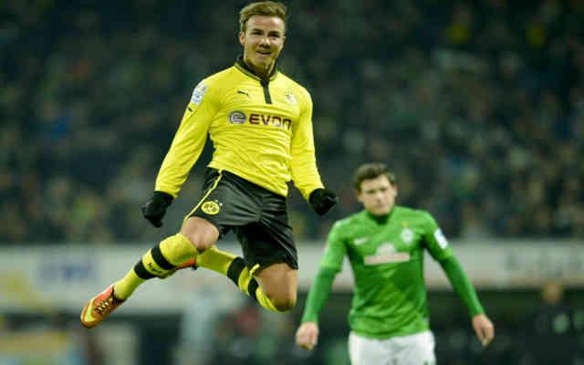 Mario Gotze celebrates his goal as Dortmund win with a landslide