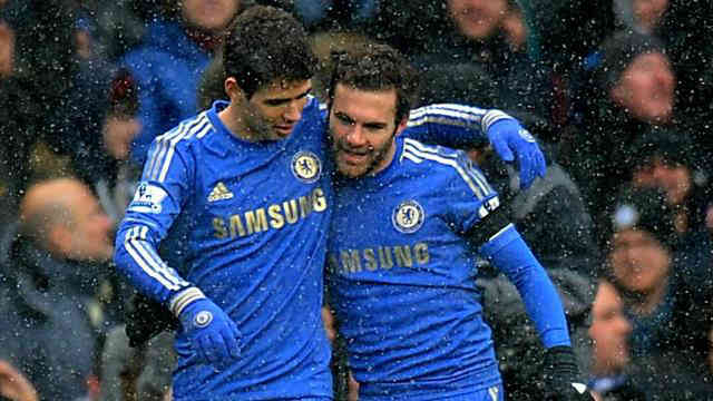 Mata celebrates his goal with Oscar as Chelsea managed to keep their win to the end against Arsenal