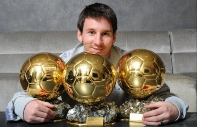 Messi shows off his three France Football Ballon d'Or. Will he get his fourth one tonight?