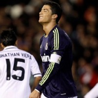Real Madrid's Cristiano Ronaldo, centre, reacts after failing to score against Valencia during their Copa del Rey match in Valencia,