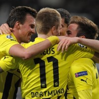 Borussia Dortmund claimed a 2-2 draw at Shakhtar Donetsk to take a big step toward the Champions League quarter-finals on Wednesday.