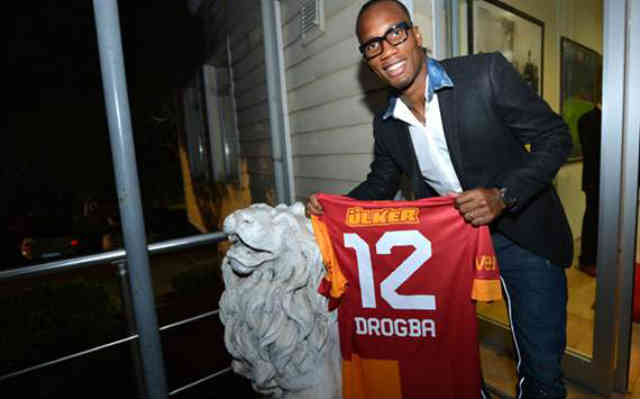 Drogba holding his Jersey and would be playing in the Champions League again