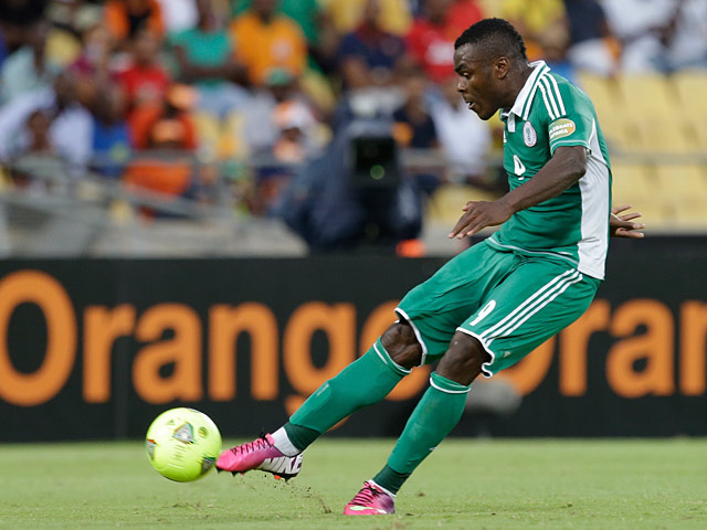 Nigeria's Emmanuel Emenike takes a free kick to score