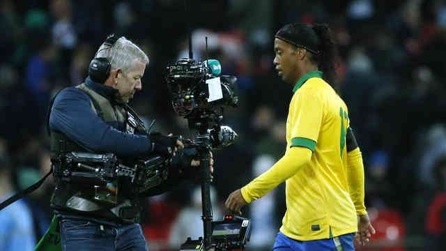 Ronaldinho taken of the pitch as he misses that penalty that could of changed their game against England