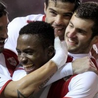 Two first half goals were all Rayo Vallecano needed as they held off Atletico Madrid's second half surge and jumped back in to a Europa League spot.