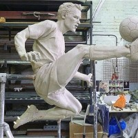Dennis Bergkamp says he is 'honoured' that the club plans to erect a monument in his likeness outside the Emirates Stadium.