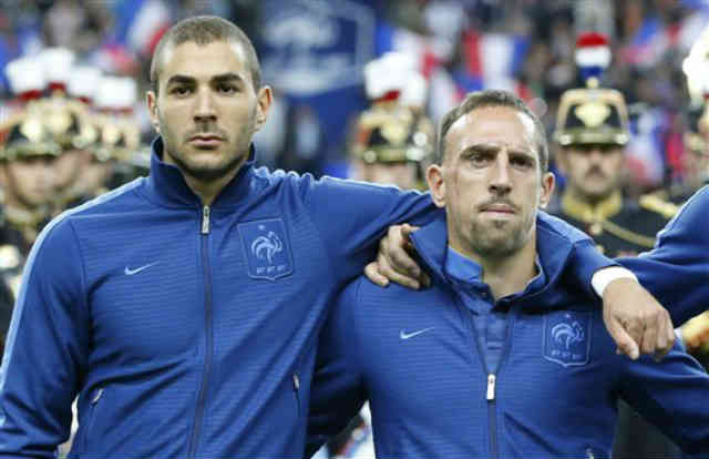 Karim Benzema and Franck Ribery stand to together as a team for France