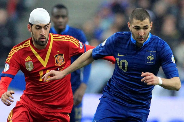 Karim Benzema here pictured with Busquets reckons that France did not deserve to lose against Spain