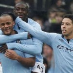 Kompany celebrates his goal with his team