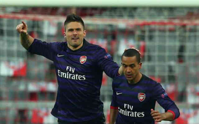 Olivier Giroud celebrates his goal with Theo Walcott but beleives the Gunners are rising