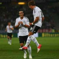 Ozil and Gotze celebrate for their win