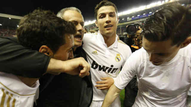 Jose Mourinho celebrates with his men for the victory