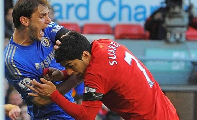 Luis Suarez bites Liverpool striker Branislav Ivanovic during the Liverpool-Chelsea clash