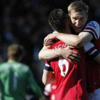 Mertesacker celebrates his goal that gave victory for Arsenal