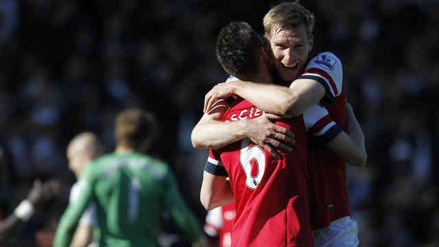 Mertesacker celebrates his goal that gave victory for Arsenal