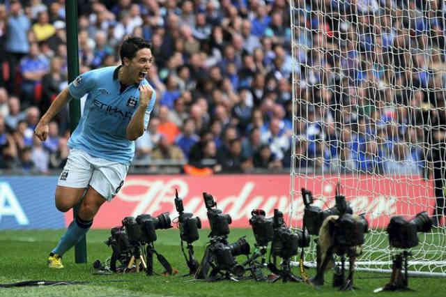 Samir Nasri celebrates the open goal for Manchester City