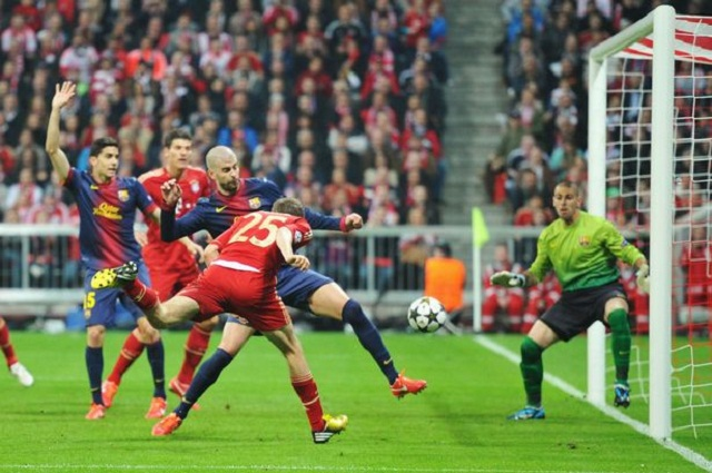 Thomas Mueller scores the opening goal for Bayern Munich, he will score another one in this 4-0 victory over Barcelona- he is our Man of the Match