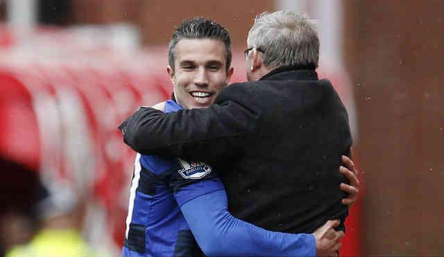 Van Persie celebrates his goal with his manager Sir Alex Ferguson