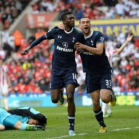 Adebayor celebrates his goal as he puts Tottenham in the safe zone