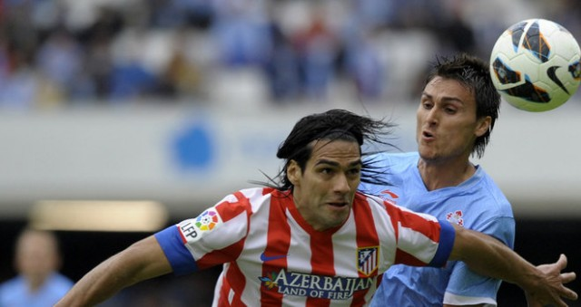 Atletico Madrid scored twice in the second half to hand relegation battlers Celta Vigo a potentially crushing 3-1 loss.