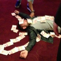 Bardsley appeared to enjoy his winnings a touch too enthusiastically though, and was pictured lying down before friends covered him in banknotes