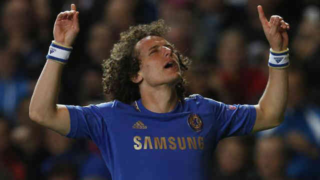Luiz scoring celebrating his goal as he scores a stunning goal