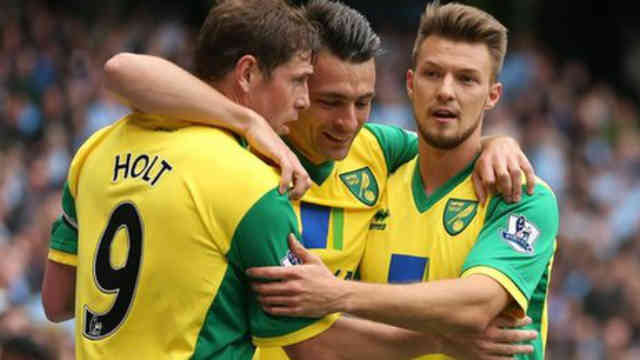 Norwich City celebrate their goal against Manchester City