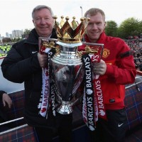 Paul Scholes and Sir Alex Ferguson exhibiting the English Premier League trophy 2013