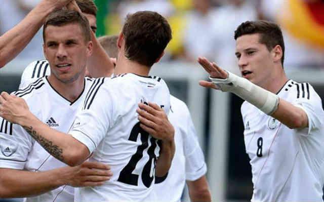Podolski celebrates his goal with his team mates