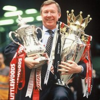Sir Alex Ferguson with an armful of trophies