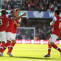 Theo Walcott celebrates with his team for his goal