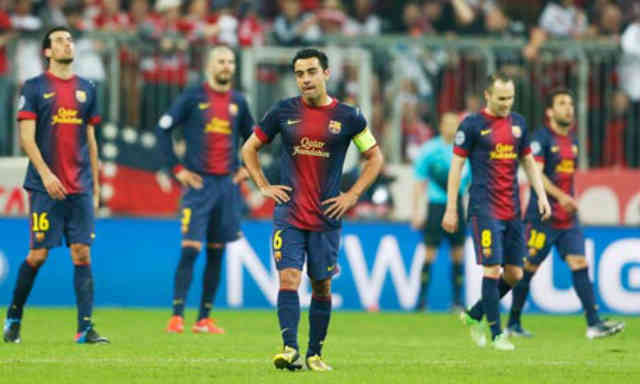 Xavi and his team mates couldn't believe with the result and being kicked out of the Champions League