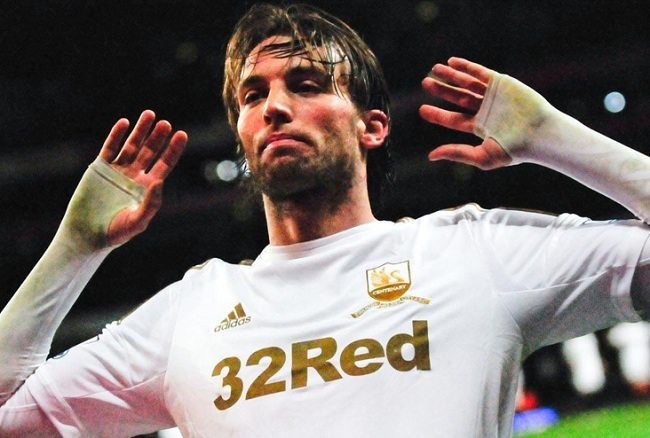 Swansea's Spanish star Michu celebrates