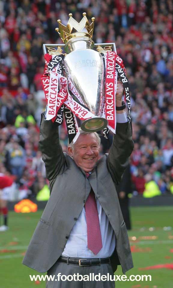 Sir Alex Ferguson winning won of the many trophies