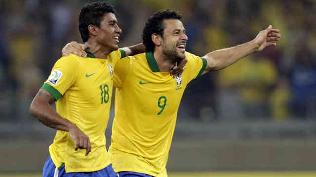 Fred and Paulinho celebrate their goals as Brazil off to the finals