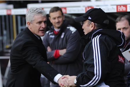 New Stoke City boss Mark Hughes, shares a handshake with old boss  Tony Pullis in diferent times