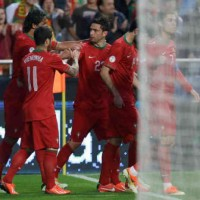 Postiga comes to the rescue for Portugal
