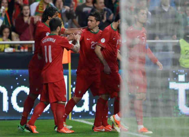 Postiga comes to the rescue for Portugal